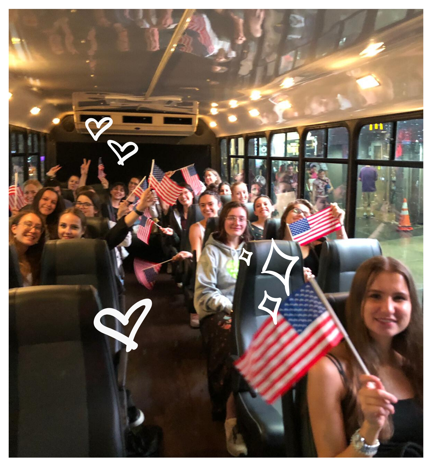 au pairs on bus waving american flags