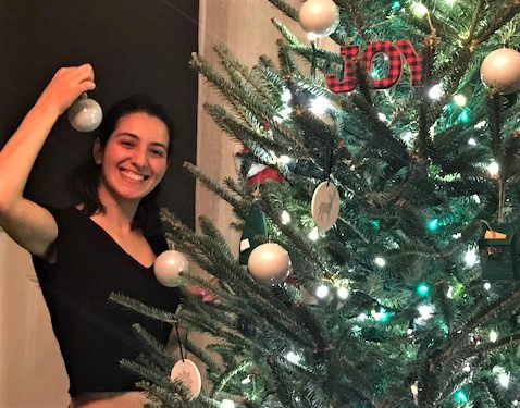 Turkish au pair Cansu helping decorate at Christmas with her host family