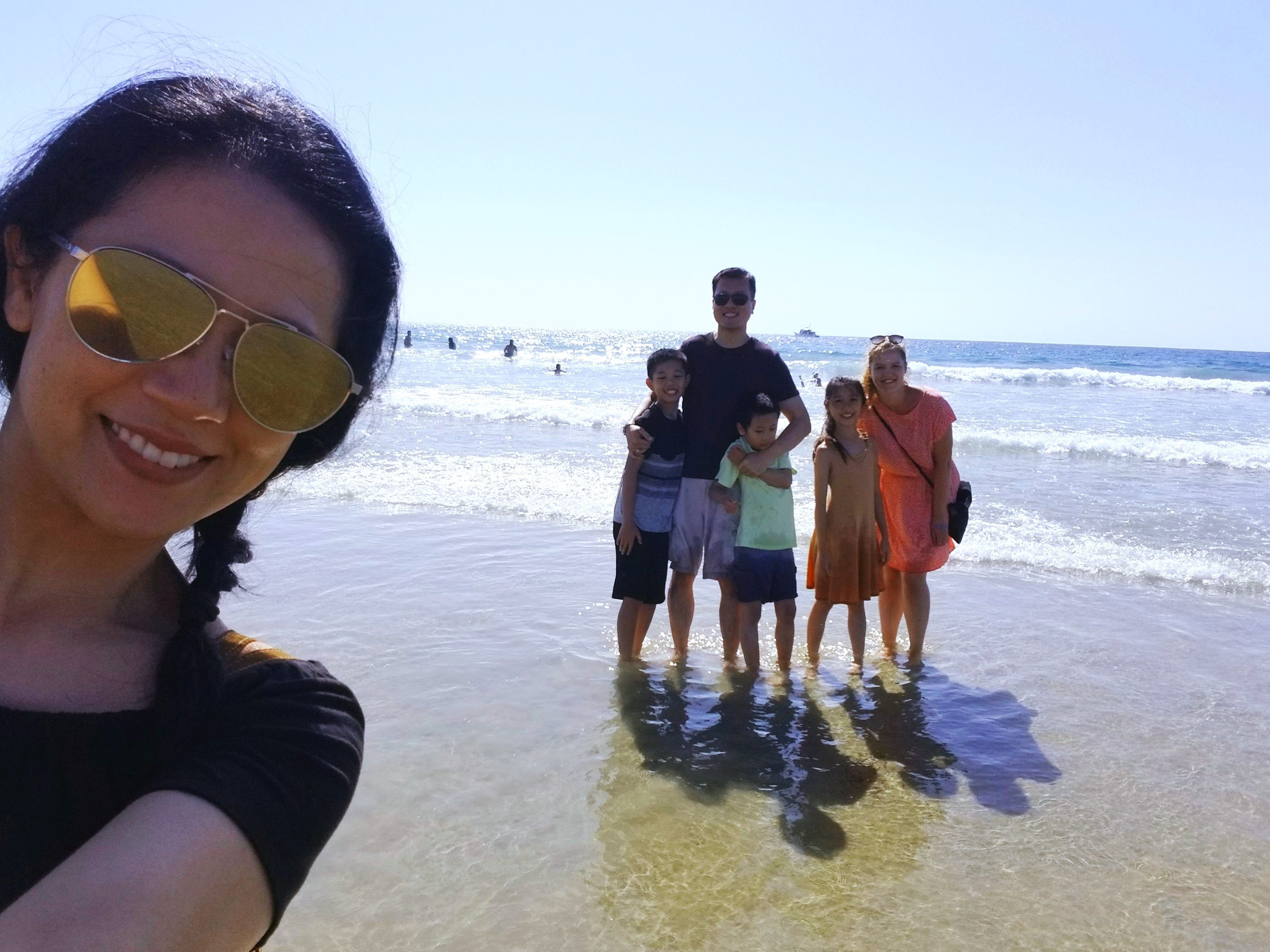 california host family with german au pair at beach