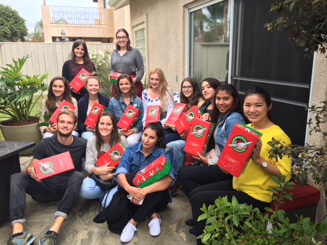 au pairs create gift boxes for community