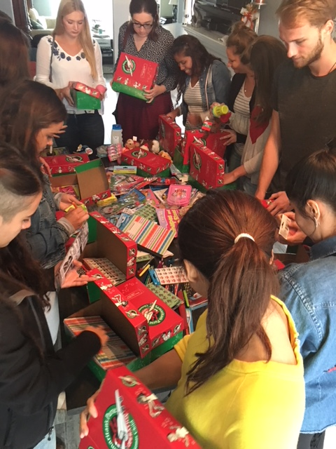au pairs put together gift boxes for christmas