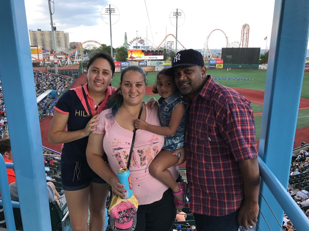 au pair and family bonding at a baseball game
