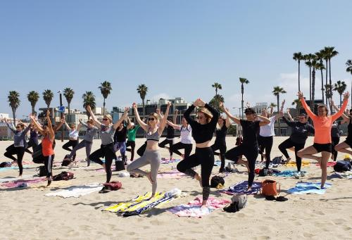 Southern California Area Director leads au pairs in beach yoga to celebrate Earth Day