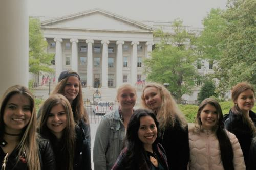 Au pairs wait outside the US Treasury in Washington, D.C.