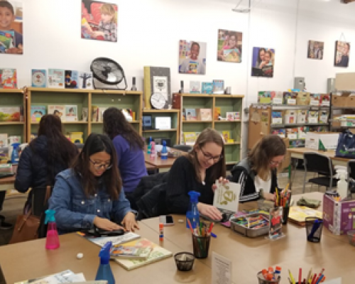 Live-in au pairs in Oregon volunteering at Children's Book Bank