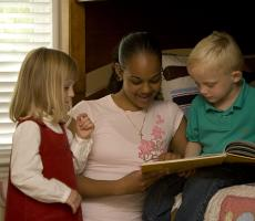 Au Pair Reading with Host Children