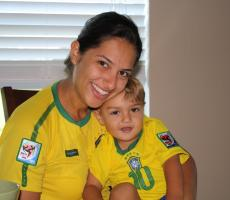 Brazilian Au Pair and Child Celebrating World Cup