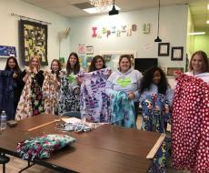 Au pairs make blankets for the community